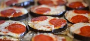 keto eggplant pizzas on baking sheet