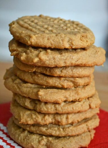 peanut butter cookies stacked on a white plate