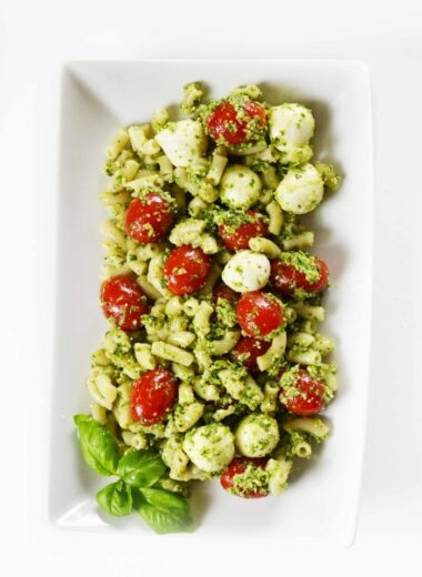 Pesto pasta salad on white rectangle dish