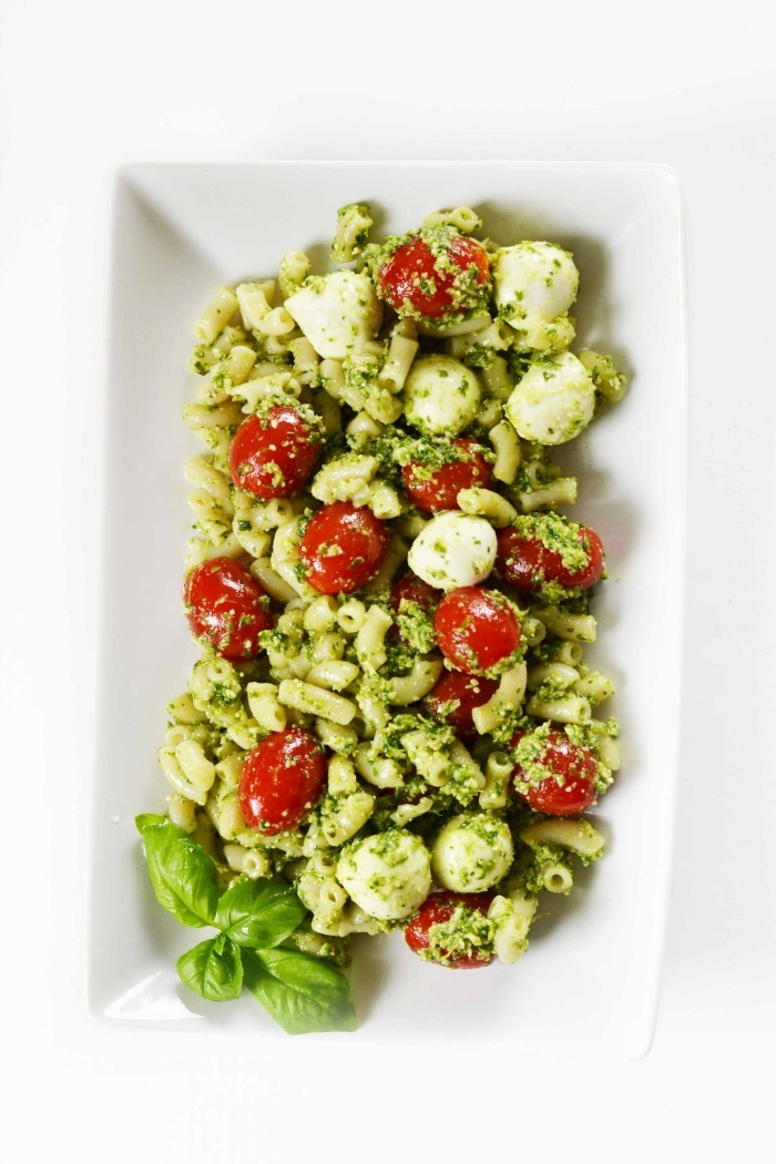Pesto pasta salad on white rectangle dish