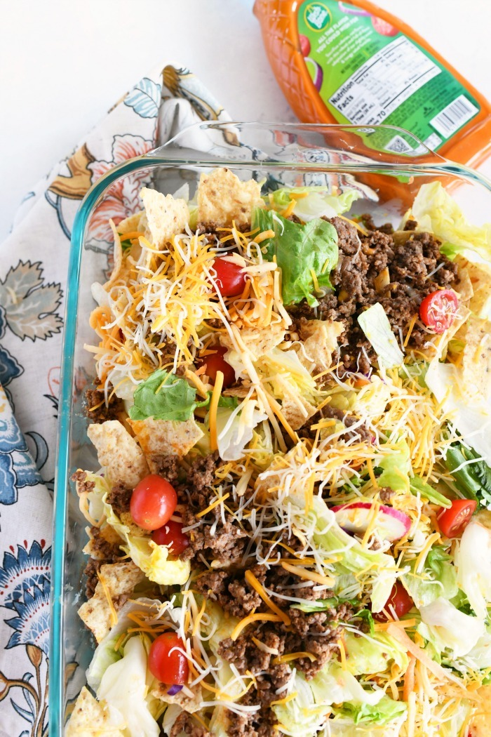 Taco salad recipe in Pyrex with napkin