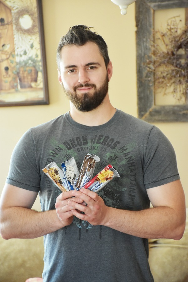Guy-holding-pure-Protein-bars