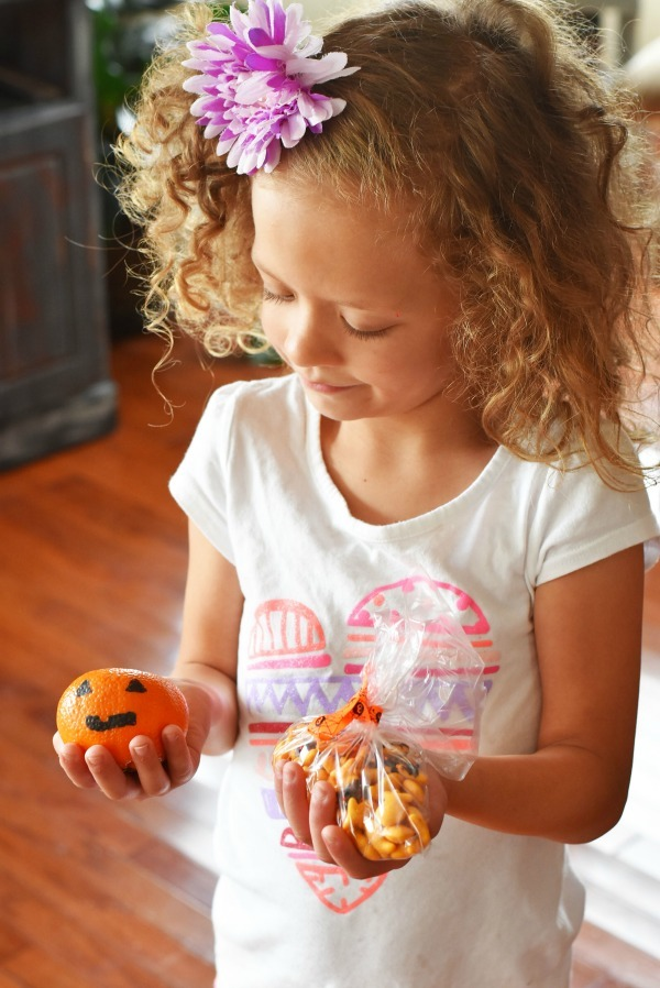 girl-holding-halloween-snacks