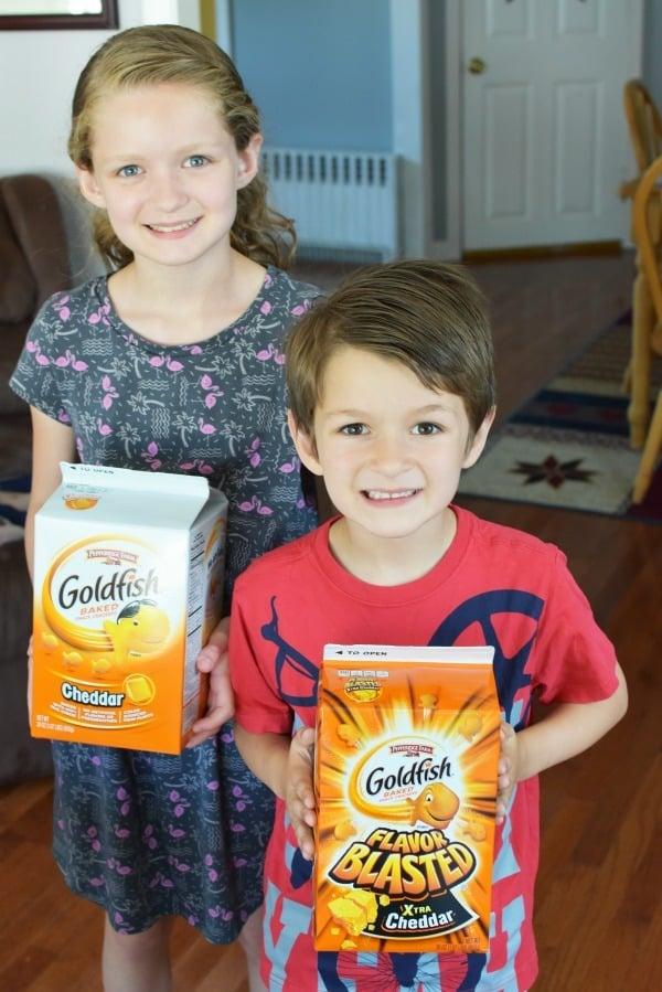 Kids holding Goldfish