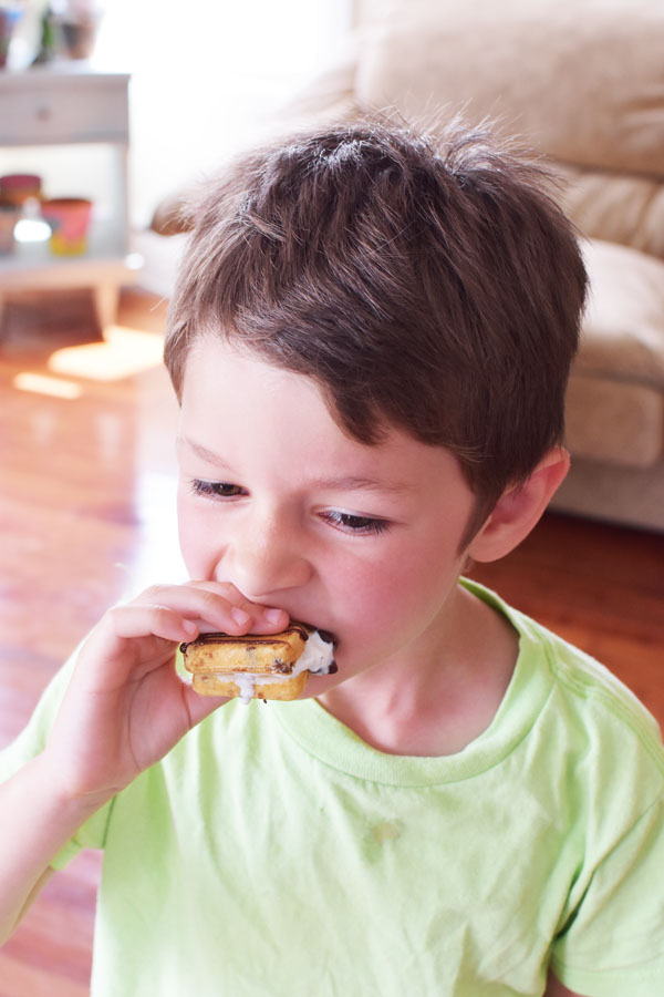 boy eating ice cream sandwich
