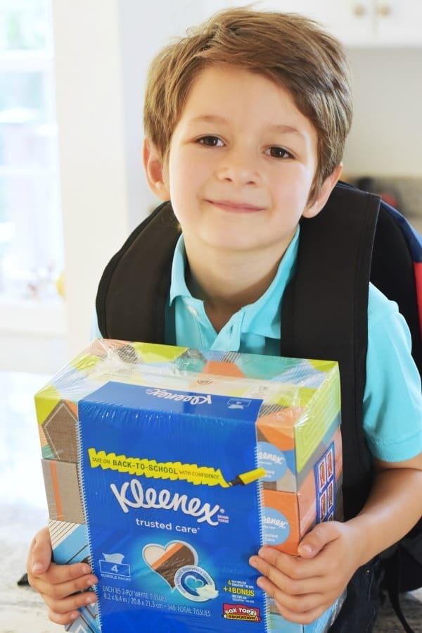 Boy holding Kleenex