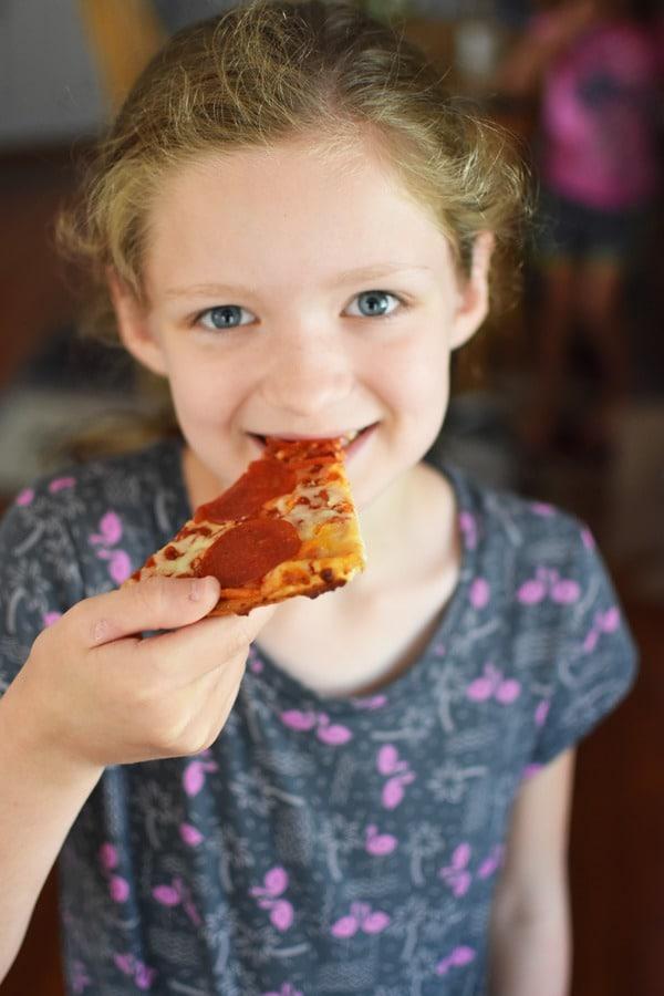 Girl Eating Pizza