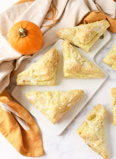 Pumpkin puff pastry with a real pumpkin nearby.