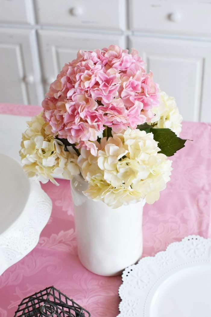 Pink and white hydrangeas in white vase