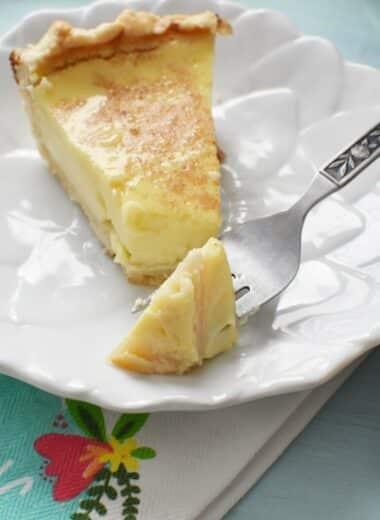 slice of custard pie on white dish