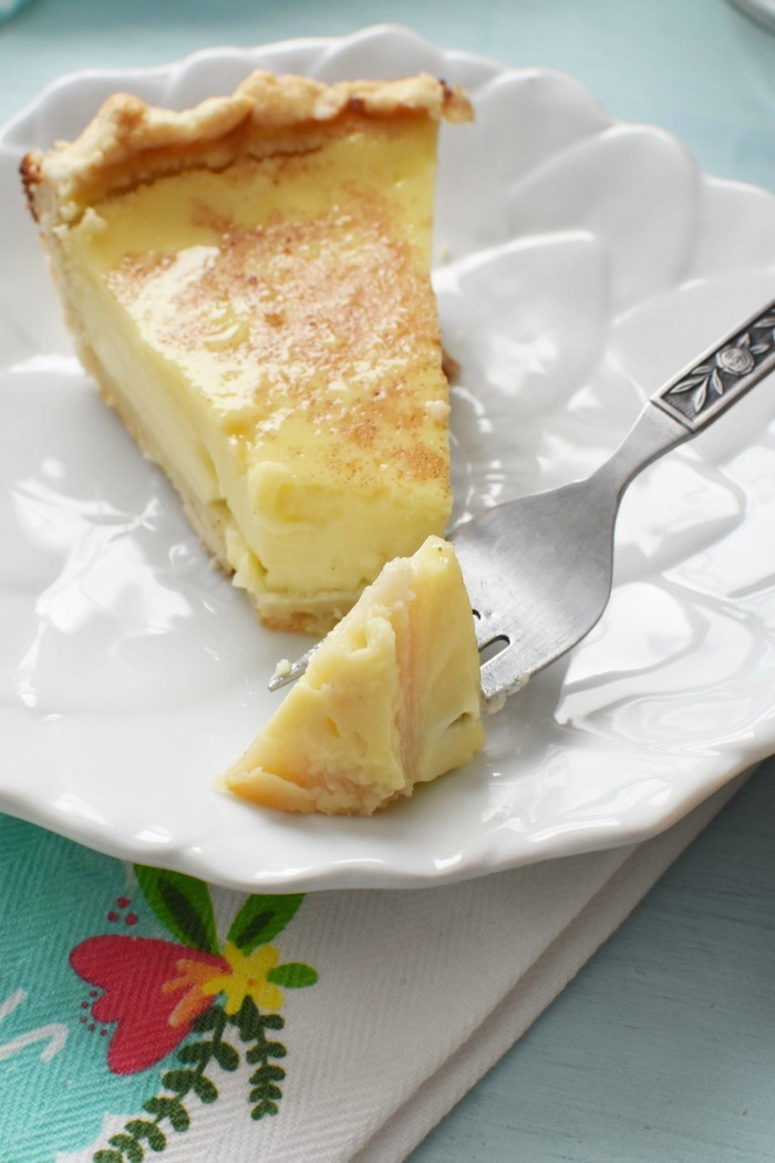 slice of custard pie on white dish