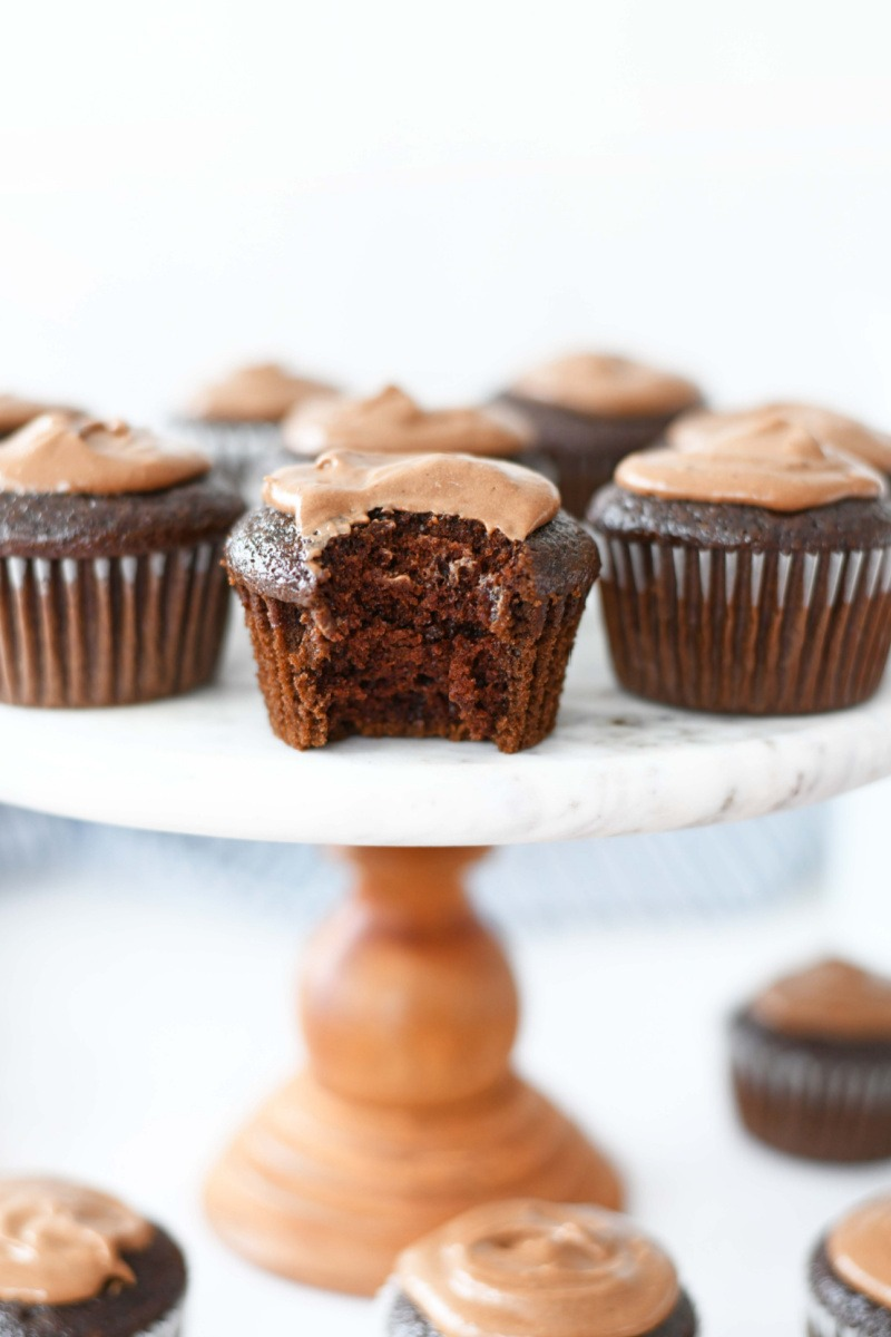 Chocolate Frosted Mayo cupcakes on a white cake stand.