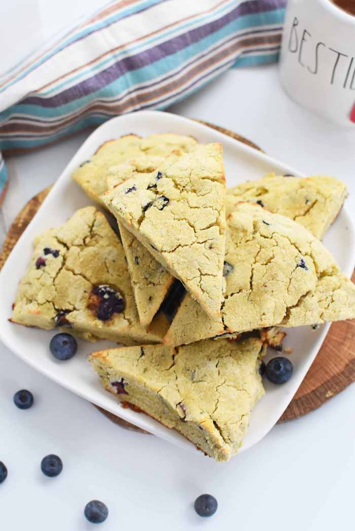 Coconut & Almond Flour Blueberry Scones on a square white table.