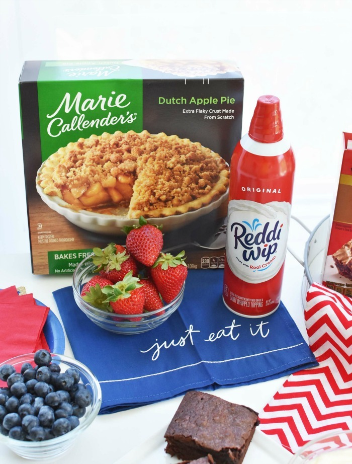 pie box with red strawberries and can of reddi-wip