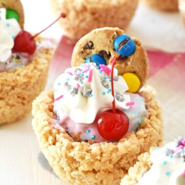 unicorn sundaes with a cherry and colorful cookie