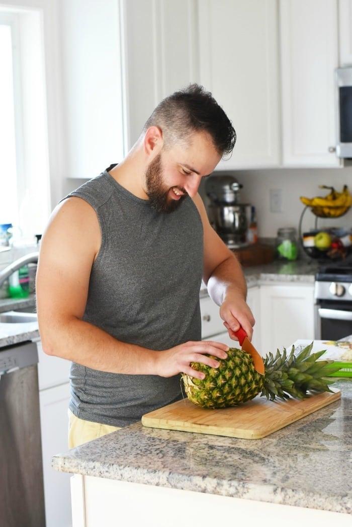 Man cutting pineapple