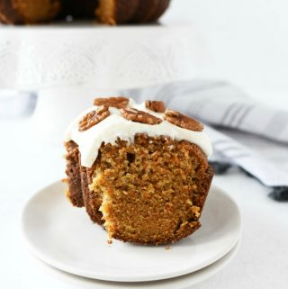 slice of carrot cake on a white plate