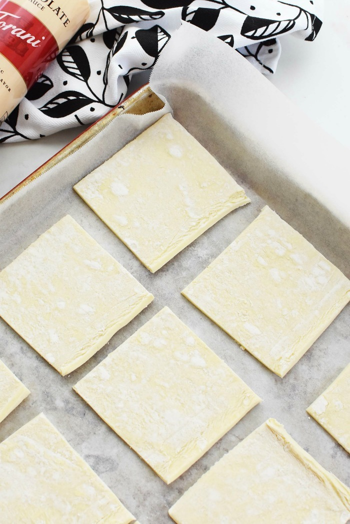 Puff Pastry squares on baking sheet