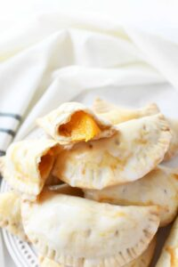 Peach hand pies inside on white napkin