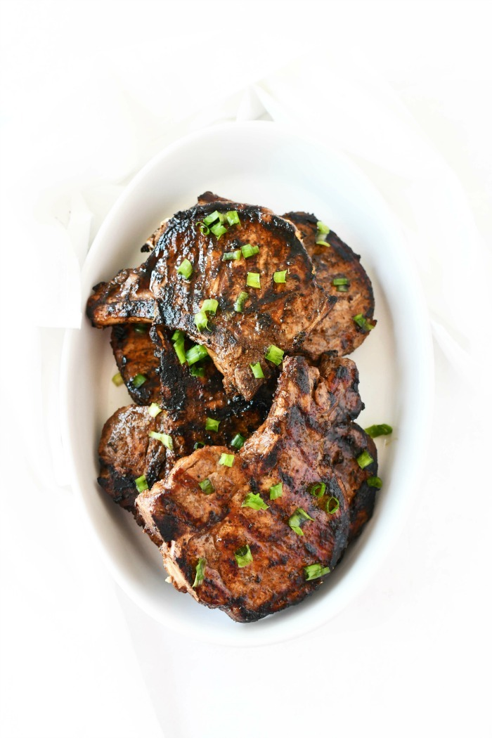 Asian Pork chops marinade recipe cooked in white dish.