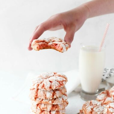 Strawberry cake mix cookie recipe in hand with milk