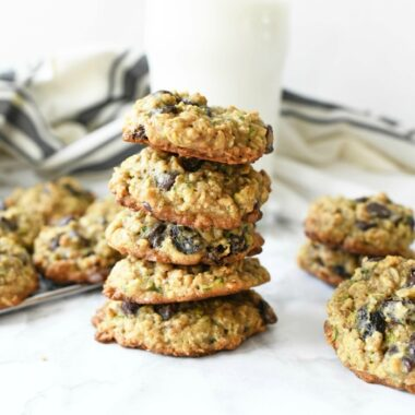 Zucchini Oatmeal Chip Cookies in a stack with milk,