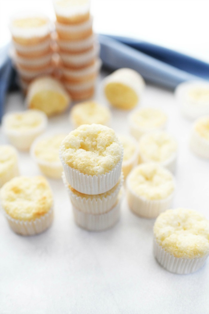 Angel Food Cupcakes Recipe unfrosted, stacked on a white table