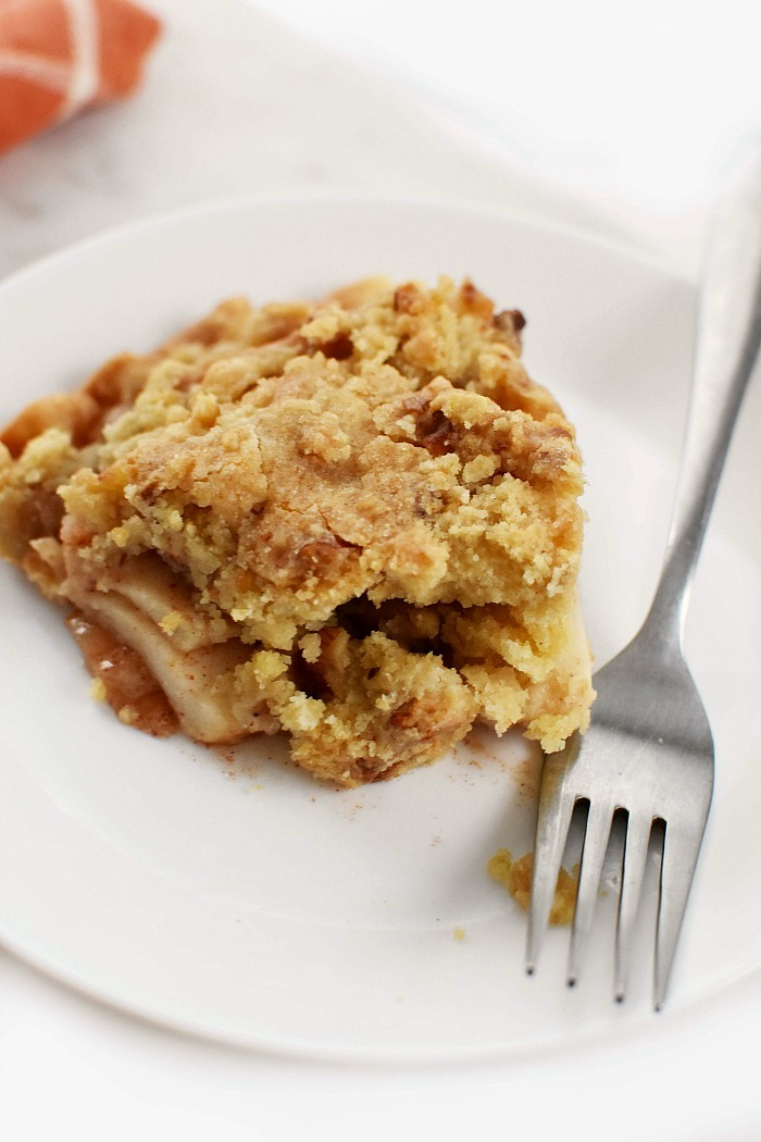 Apple Crumb Pie Slice with silver fork.