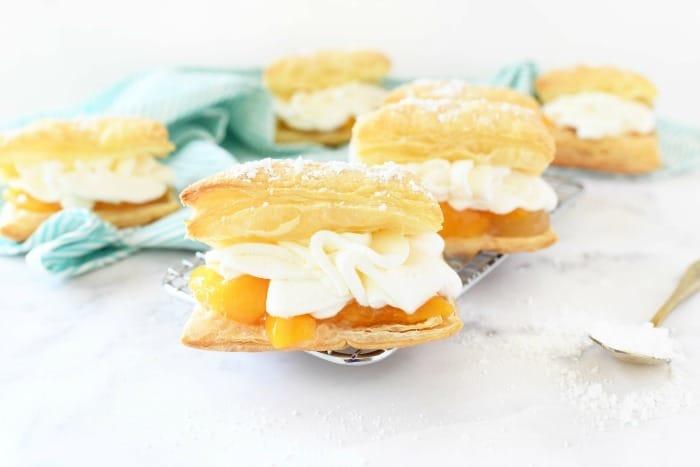 Peaches & Cream Napoleons on white table with a blue napkin.