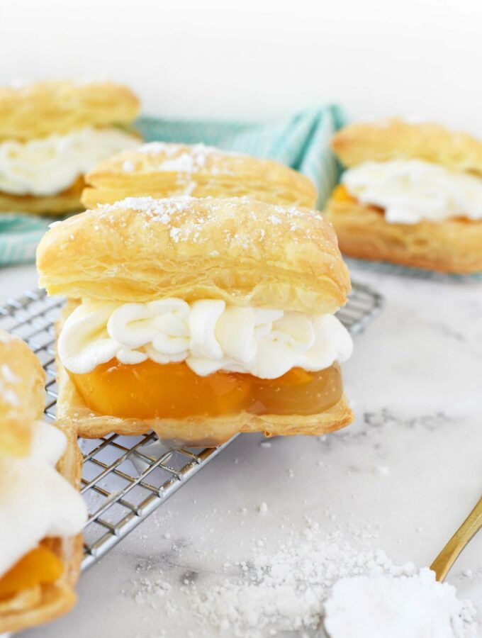 Peaches & Cream Pastries on a wire rack.