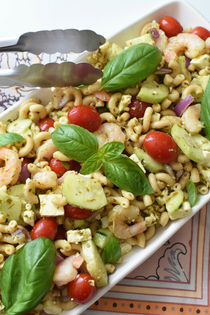Pesto and Basil Shrimp Pasta Salad in white rectangle plate.