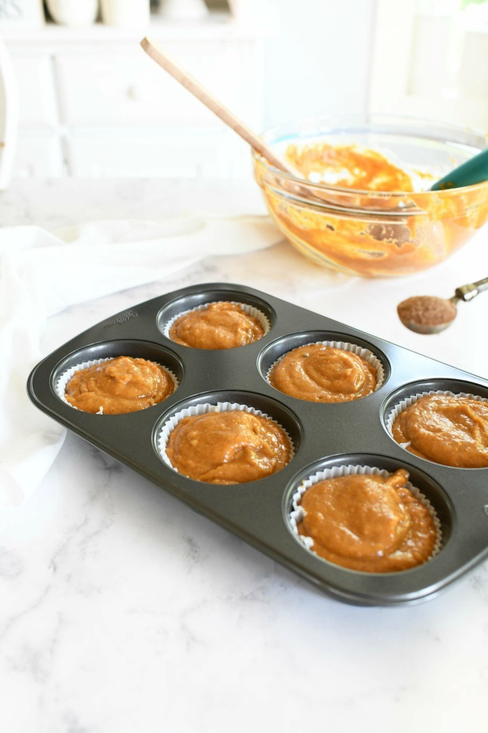 Pumpkin jumbo muffins batter in muffin tin.