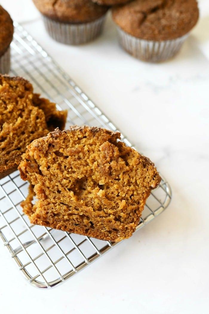 Pumpkin spice jumbo muffins split in half.