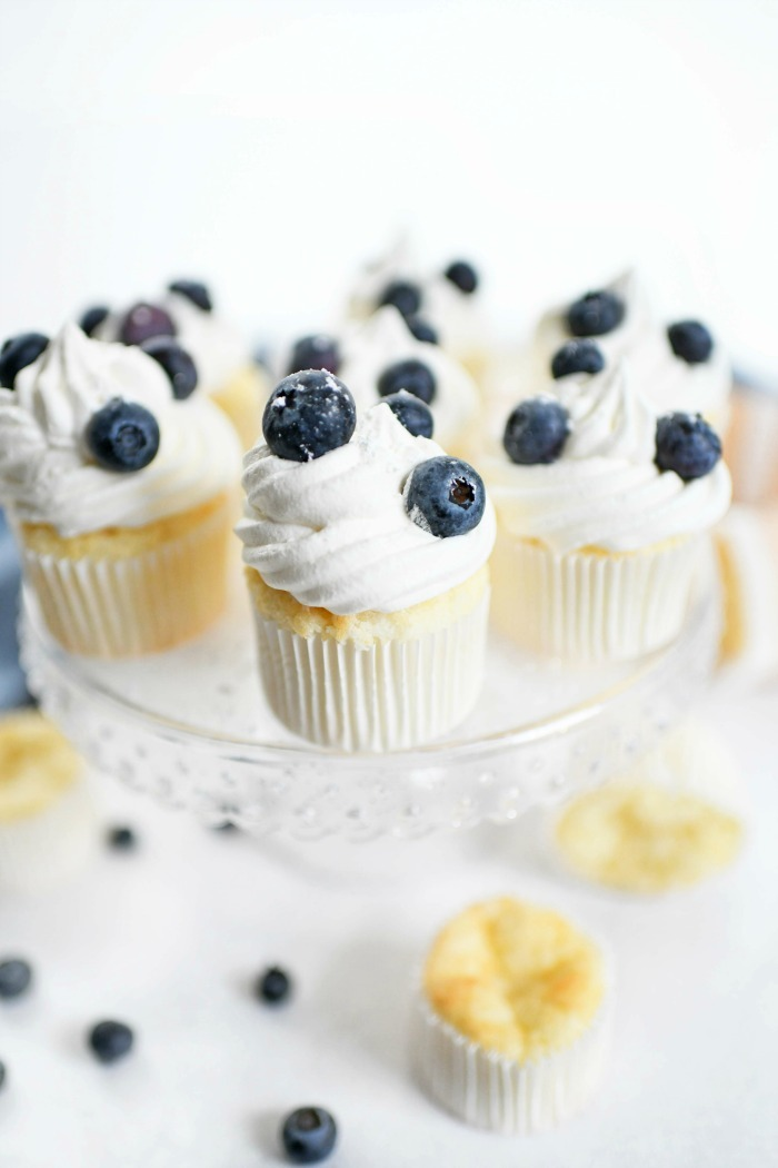 WW cupcakes on a clear cake stand with blueberries