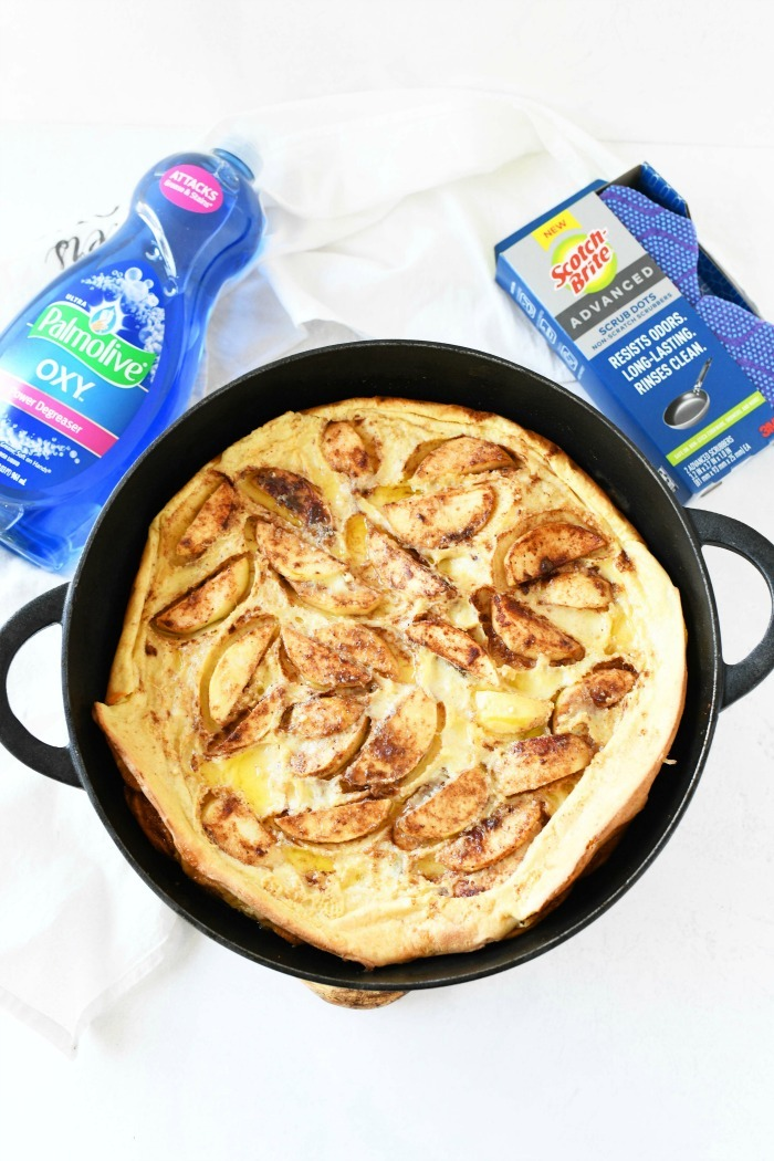 Baby apple pancake in a cast iron pan with Palmolive, and scotch brite nearby.
