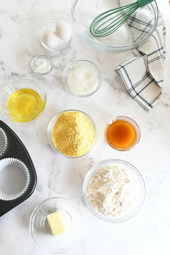 Corn muffin ingredients on a white table.