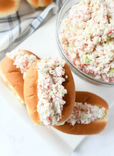 Deli Style Seafood Salad finger rolls on a white platter.