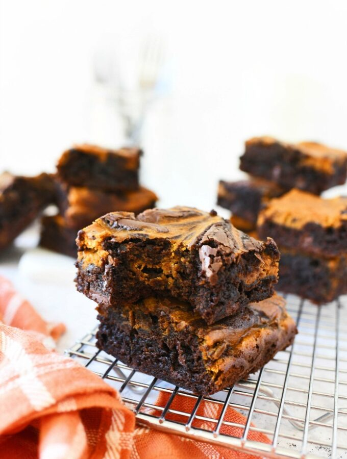 Pumpkin Fudge Brownies on a cooling rack with a bite missing