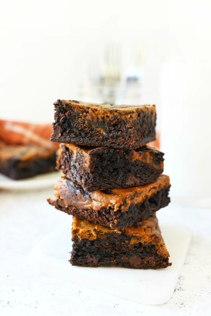 Pumpkin brownies stacked.