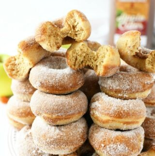 Apple Cider Sugar Donuts with bites on a white tray.