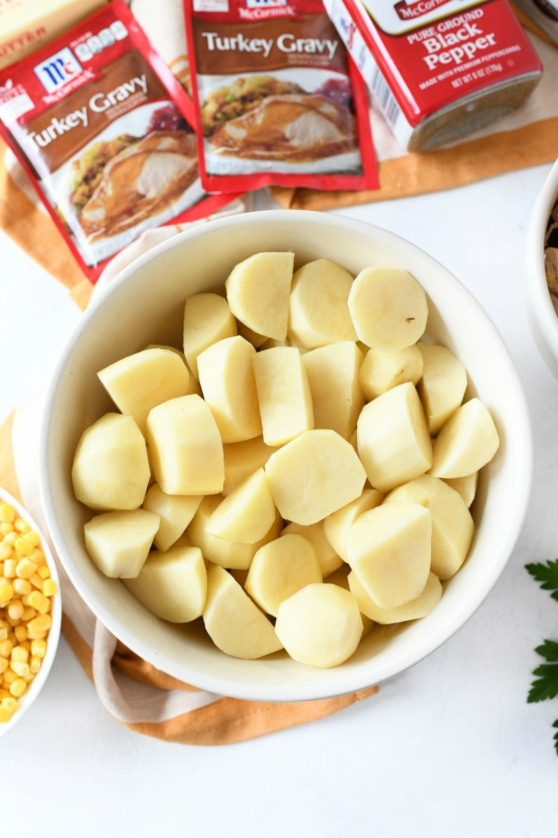 Cubed Russet Potatoes in a white bowl.