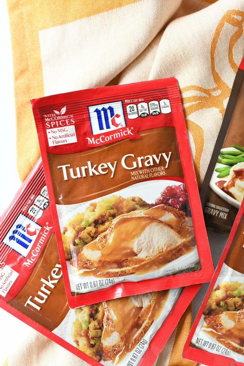 McCormick Turkey Gravy packets on a pumpkin napkin.