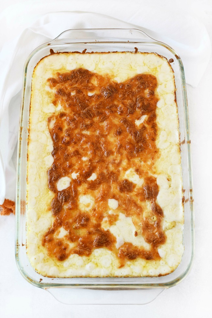 Oven baked macaroni and cheese in a Pyrex deep dish pan.
