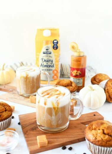 Salted caramel latte drink with caramel cubes, milk, and muffins.