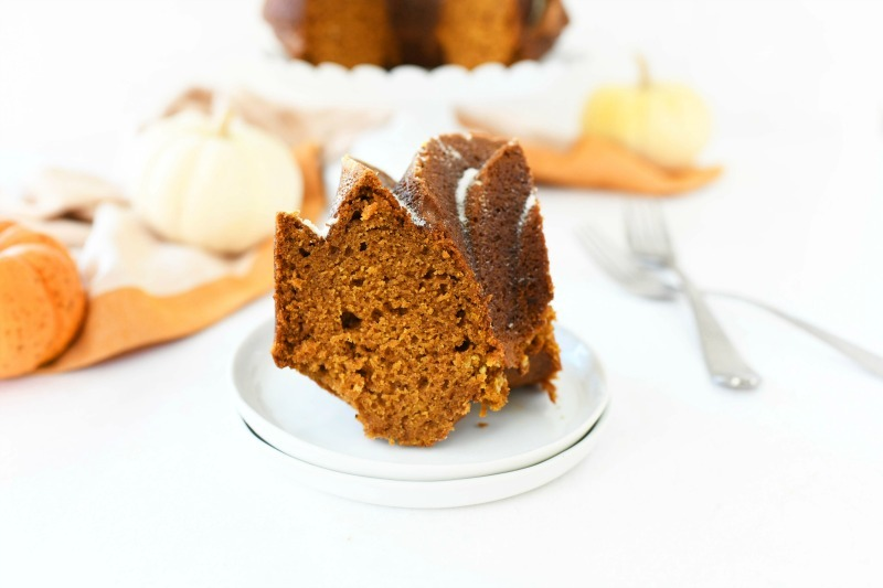 6 cup bundt cake slice on little white plates with a fork.