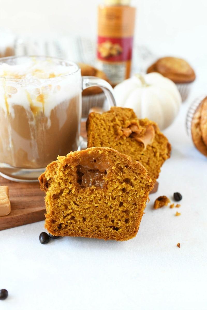 Caramel Pumpkin Muffins near a latte.