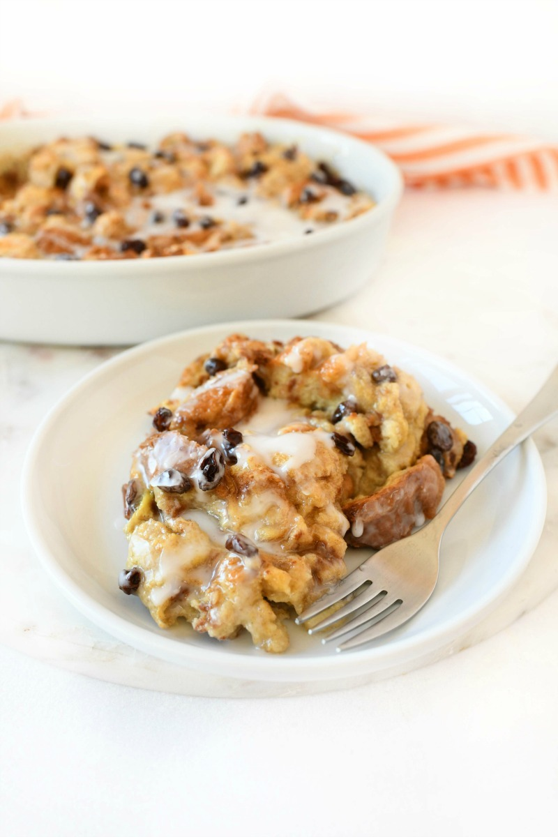 Cinnamon French Toast Casserole in a white dish with a fork.