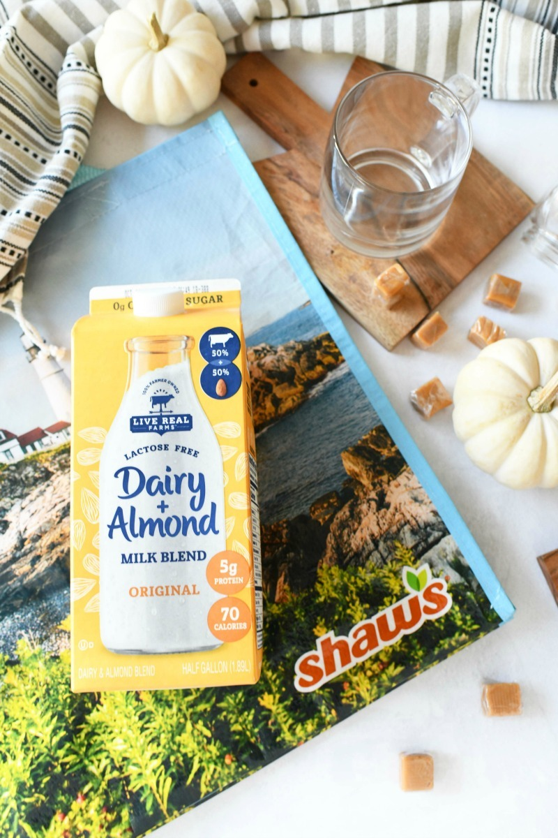 Dairy Blend with Almond Milk on a white table with a Shaw's bag.