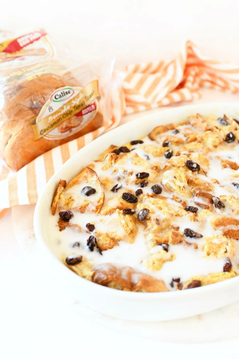 Iced french toast bake with an orange napkin nearby.
