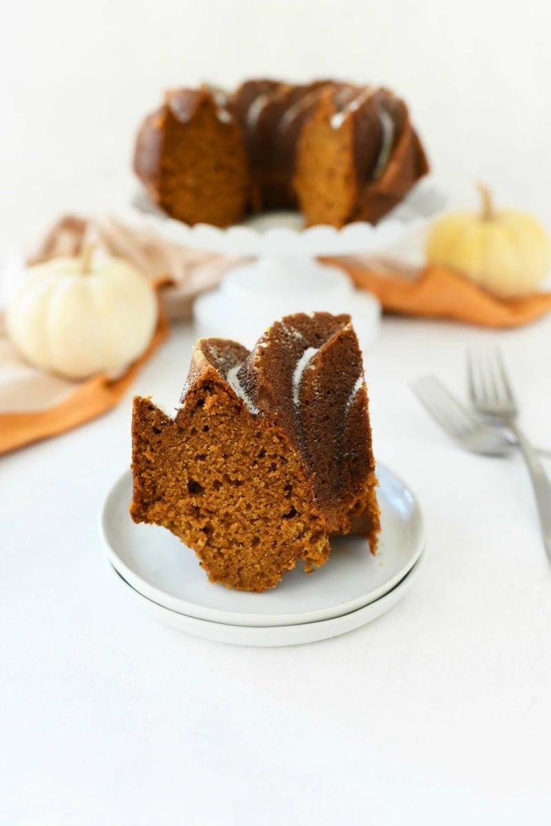 Pumpkin Bundt Cake slice on a white plate.